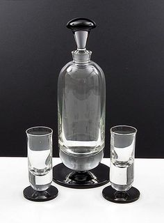 Liqueur carafe with two liqueur glasses clear glass with black glass applied stands black glass top of stopper design A.D.Copier 1932 executed by Glasfabriek Leerdam / the Netherlands