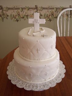 First Communion Cake.  Covered in MMF, decorations in gumpaste & edible pearls.  Thanks for looking.