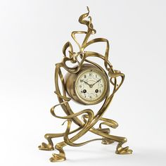 French Art Nouveau Gilt Bronze Mantel Clock by Victor Horta. The clock, dating back to 1895, is a fine example of the ornamental delight that the architect brought to even the smallest details of his projects. As one element of a larger ensemble, the clock shows how inventively Horta employed his characteristic asymmetrical curve on a reduced scale. A similar clock is pictured in The Kogod Collection,edited by Tam Curry Bryfogle; and Art Nouveau, by Judith Miller.
