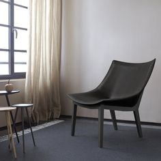 MADRAQUE  Design:  Francois Azambourg 2014. Following on from the success of Grillage, we have this statement chair available in fabric & Alcantara but probably best shown in pigmented undressed hide white, black or natural tan. Leg frame in natural or anthracite stained wood Dims: W 76 x D 76 x H 80 cm