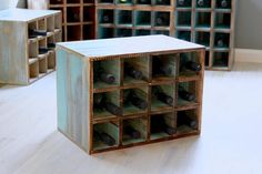FREE SHIPPING Stackable, wooden wine rack. These wooden wine boxes can be stacked vertical or horizontally to display your wine collection. Scatter them around the dining room or create a unique display to fit your living space. Each distressed design is hand crafted, hand painted