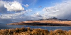 Wonderful view from Islay to the Pabs mountains of the isle of Jura, Scotland. Scotland Places To Visit, Isle Of Jura, West Coast Scotland, Scottish Islands, Majestic Animals, Scotland Travel, Countries Of The World, Ancestry, Sunsets