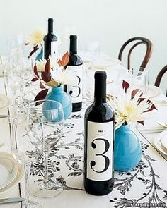 Wine bottle table numbers! This would be really cute with our favorite wine brands.