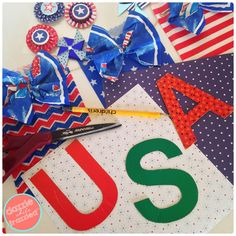 DIY U.S.A. patriotic banner for 4th of July using patriotic-themed paper goodie bags and cocktail napkins. Easy Red White and Blue DIY home decor craft.