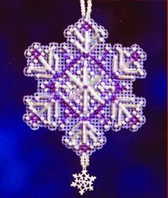 """This is a design in the Mill Hill Snow Crystals Charmed Ornament Series.  This complete kit includes Mill Hill Glass Beads, Mill Hill Charm, 14-count perforated paper, floss, needles, and chart with instructions.  The design size is 2.25"""" x 2.75""""."""