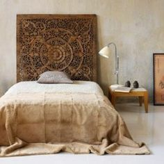 Carved teak headboard ~This is a little *too* plain - maybe a little color on the walls, a pale shade of mauve, perhaps - but when you have an impressive piece like this headboard, this is the way you treat it. You don't have a lot of clutter and a zillion pillows on the bed. FC~