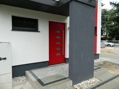 Modern Entrance Door from Aluminum in custom color in combination with an accent wall.