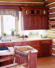 Idea of the Day: Log Home Kitchens. (By Crown Point Cabinetry). Pretty nice, red early american island log home beadboard New Kitchen, Kitchen Decor, Kitchen Ideas, Log Home Kitchens, Rustic Kitchens, Red Kitchen Cabinets, Crown Point Cabinetry, Diy Kitchen Remodel, Kitchen Gallery