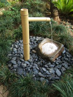 Zen garden fountain- elements of black river rock and bamboo Bamboo Water Fountain, Garden Water Fountains, Water Garden, Outdoor Fountains, Indoor Fountain, Small Japanese Garden, Japanese Garden Design, Diy Water Feature, Zen Garden Design