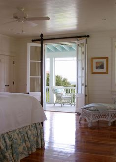 The master suite opens to a screened porch on the back of the house and overlook a private garden.