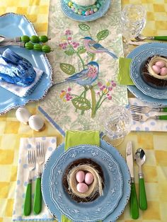 Who says the kids Easter table can't be stylish? Spring couldn't be any brighter with this colorful wimsical tablescape. Bright yellow checkered table cloth, green toile embroidered bird and floral runner, rick rac lined polka dot napkins, vintage inspired melamine plates, gold lined ceramic egg salt and pepper shakers, pink egg filled nests, pastel mercury glass rabbits and acrylic water and mocktail glasses all from HomeGoods. Setting the table never's been so Happy! (Sponsored)