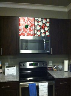 Easy Christmas DIY. Wrapped kitchen cabinets with a bow.