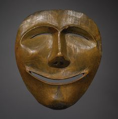 An Eskimo Wood Mask, Point Hope, composed of carved wood,depicting the moon. Sotheby's AMERICAN INDIAN ART 23 MAY 2008 NEW YORK