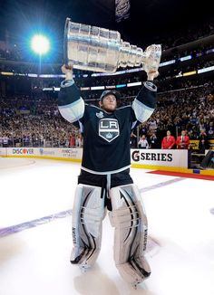 Los Angeles Kings goalie Jonathan Quick holds up the Stanley Cup after the  Kings beat the New Jersey Devils Game 6 of the NHL hockey Stanley Cup  finals 777e41e8a