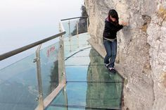 Tianmen Mountain's glass path 4700ft high allows visitors to look down at the peaks of smaller mountains below