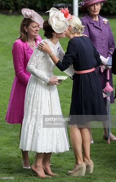 Catherine, Duchess of Cambridge kisses Zoe Warren as she attends the second day of Royal Ascot at Ascot Racecourse on June 15, 2016 in Ascot, England.