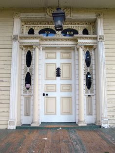 the Crawford house could just as well be described as a very high style late Federal house. Whatever you call it, the design of the front door is extraordinary, the usual Federal period restraint taken to positively baroque extremes. BIG OLD HOUSES: A Fine Survivor in a Gritty Town