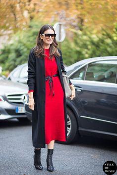 Street Style via Style Du Monde. Red midi dress, long black coat, black booties.