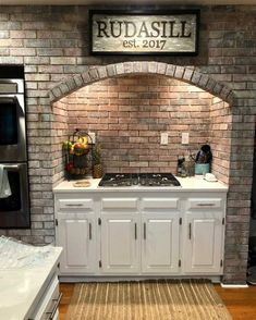 This is an ad for the Large 100 Year Old Barn Wood Hand Burned Family Name Sign.but I'm totally diggin the old world style alcove/hearth for the stove! Home Renovation, Home Remodeling, Casa Patio, Kitchen Stove, Kitchen Brick, Rustic Kitchen Design, Beautiful Kitchens, Kitchen Styling, Home Kitchens
