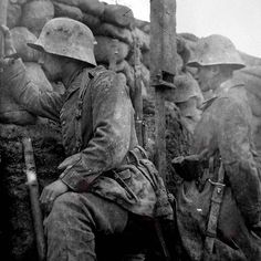 WW1: German soldiers use trench periscopes to glass the enemy line. The periscope was the only effective way of avoiding getting shot by snipers. Both sides used it extensively.