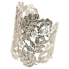 """Brass cuff with a handmade floral openwork design in silver.  Product: CuffConstruction Material: BrassColor: SilverFeatures:  Handmade floral openwork designAdjustable Dimensions: 2"""" DiameterCleaning and Care: Wipe clean with dry cloth"""