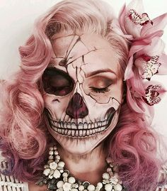 Absolutely incredible skeleton makeup with pink hair and jewels