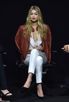 Showing her credentials: The 19-year-old dazzled in a chic white jumpsuit, revealing her c...