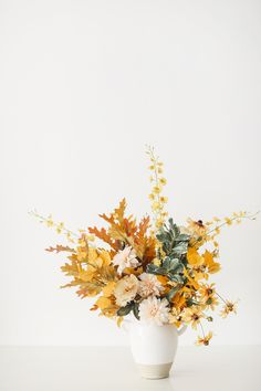 Create a tall fall floral centerpiece for your Thanksgiving tablescape or your fall home decor. Start with tall dancing orchids, fake oak leaf stems, and mix in your favorite fall-toned flowers. Shop this arrangement at Afloral.com. Fake Hydrangeas, Hydrangea Flower, Fake Flowers, Dried Flowers, Dried Flower Arrangements, Flower Centerpieces, Fall Wedding Flowers, Flower Bouquet Wedding, Fall Home Decor