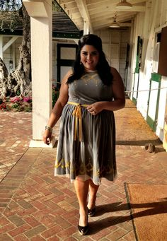 Marcy from The Marcy Minute looks ADORABLE in this grey & yellow dress!