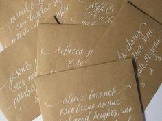 kraft paper + white calligraphy Caligrafía para Tu Boda www.caligrafiaparatuboda.com