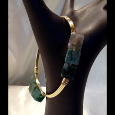 Stone Bangle This beautiful bangle features dark green stones set on a gold frame. Nine total stones. Measures 8.5 inches around. (This closet does not trade or use PayPal) Jewelry Bracelets