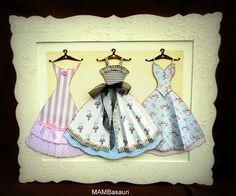 cuadro con vestidos de papel scrap