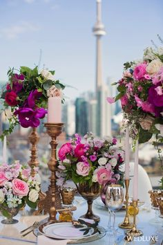 This pink candle with the pink florals! | WedLuxe – Channel Your Inner Greek Goddess | Photography by: Dave Abreu Photography Follow @WedLuxe for more wedding inspiration! #wedluxe #wedluxemagazine #wedding #weddinginspo #weddinginspiration #luxury #weddingluxury #bridal #thinkpink #pinkcandle #pinkflowers #torontoskyline
