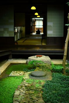 small Japanese garden with water feature and stone path; courtyard residence in Nara, Japan