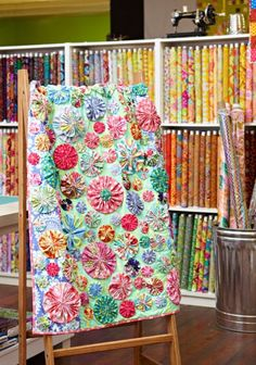 Valli & Kim | AllPeopleQuilt.com I love this example of a Yoyo Quilt. No Pattern Just Inspiration.