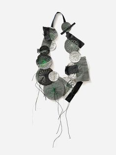 Camilla Prasch. Necklace: Vorher - grün, 2016. Cotton, wool, polyester, nylon, viscose, silk, coated leather, jersey. 62 x 33 x 4 cm. Photo by: Søren Nielsen. From series: BoilingPot Rest-Blume.