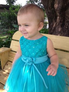 Thank you Audrey for sharing Chloe's picture with us! She looks radiant in her Nancy August Turquoise Beaded Quilt Bodice Ballerina Skirt Baby Dress!