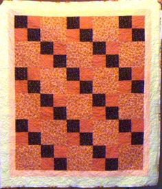 Colors of apricots and plums makes for a yummy quilt top.