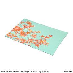 AUTUMN FALL LEAVES IN ORANGE ON MINT GREEN PLACEMAT       #autumn #fallLeaves #leaves #orange #mint #green #placemat #kitchenaccessories #kitchen #accessories #zazzle
