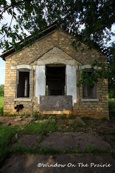 An old limestone schoolhouse, once bustling with activity, now sits silently on the Kansas prairie.