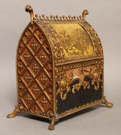 """A bronze valuables casket in the Renaissance taste having an arched top with ornate spine and finials over faux painting and elaborate ornamentation. Raised on paw feet. Ht: 11.25"""" Width: 10.5"""" Depth: 6.75"""""""