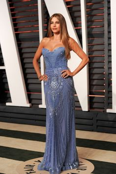 VANITY FAIR OSCAR PARTY 2015 - Red Carpet Arrivals I love  Sofia's dress on her it works well with her skin tone =) And I think she is the coolest,funniest, and smartest person out there in Hollywood =)