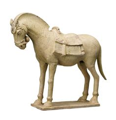 A FINE STRAW GLAZED MODEL OF A POTTERY HORSE, SUI DYNASTY (589-618)  the animal with saddle on its back, with its head slightly lowered, on a rectangular base