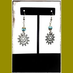 I just discovered this while shopping on Poshmark: New Retro Silver Blue Steam Punk Gear Earrings. Check it out! Price: $30 Size: OS