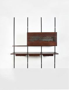 Osvaldo Borsani and Arnaldo Pomodoro; Enameled Metal, Bronze and Rosewood Wall-Mounted Storage Unit for Tecno, 1966.