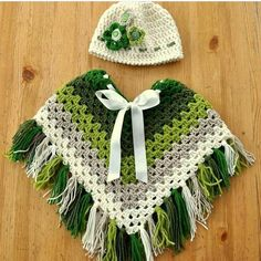 granny square kids poncho crochet pattern green poncho with fringes lively colour scheme crocheting journal - PIPicStats green poncho with fringes. A pin image only, no link to pattern or website (crochet square patterns colour) Tina's handicraft : 65 di Crochet Baby Poncho, Crochet Poncho Patterns, Crochet Baby Clothes, Crochet Shawl, Crochet Granny, Crochet For Kids, Free Crochet, Kids Poncho Pattern, Free Pattern
