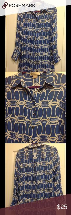 🐳🐳🐳🐳Michael Kors Tunic🐳🐳🐳🐳 🐳🐳🐳🐳Very pretty Michael Kors tunic. In a blue with a white design. It buttons down the front. It's a sheer material. It's 100% silk and in excellent condition.🐳🐳🐳🐳 Michael Kors Tops