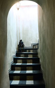 illuminated passage up.... brilliant use of black and white tiles on stair pads, risers and edge....  My Paradissi: A whimsical riad in Marrakech