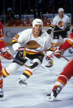 Gino Odjick of the Vancouver Canucks skates on the ice during an NHL game against the Calgary Flames circa 1995 at the Rogers Arena in Vancouver. Nhl Games, Hockey Games, Ice Hockey, Canada Hockey, Star Wars, Hockey Stuff, Vancouver Canucks, Nfl Fans, Field Hockey