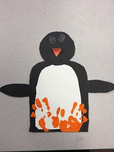 Preserve children's handprints with this penguin craft!